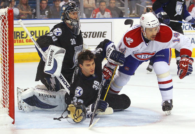 Canadiens center Tomas Plekanec is held by the Lightning's Mike Lundin during Tampa Bay's 3-0 home victory on Jan. 27.