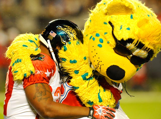 AFC running back Maurice Jones-Drew of Jaguars is congratulated by the mascot after scoring a touchdown during the second half of the Pro Bowl.