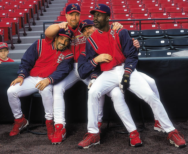 Fernando Vina, McGwire, Jim Edmonds and Shawon Dunston posing on the field during an SI photo shoot.
