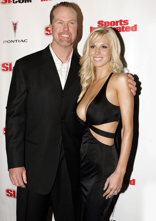 McGwire and his wife, Stephanie, pose at the 2005 SI Swimsuit party. The two appeared together in the issue.