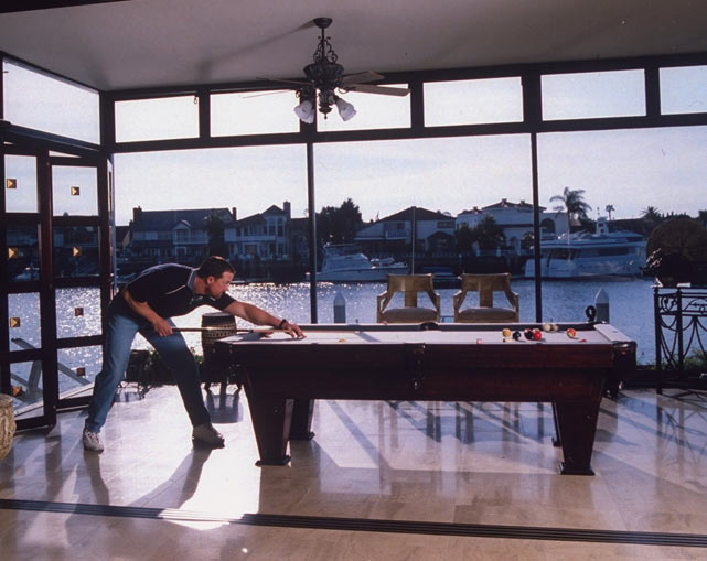 McGwire plays billiards at his home in Huntington Harbour, Calif.