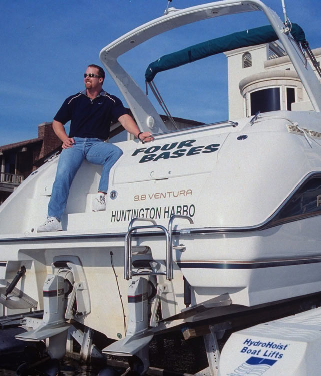 "McGwire looks out at the Pacific Ocean from his boat, ""Four Bases."""