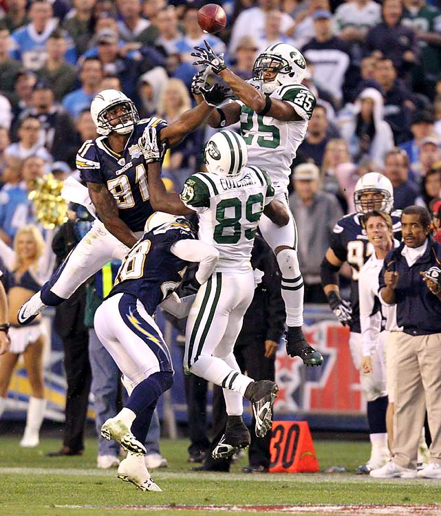 Kerry Rhodes of the Jets gets to the ball on an onsides kick attempt before San Diego's Kassim Osgood can.