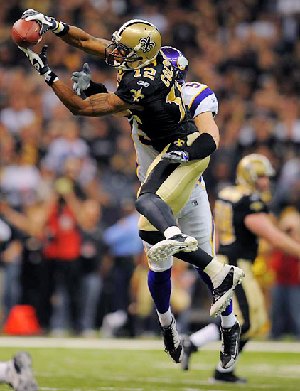 Marques Colston makes a leaping catch over the middle during the Saints overtime victory.