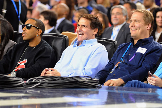 The Mavericks owner seems to be enjoying himself, but the bigger story here: Ludacris is wearing shades while watching a basketball game indoors. Interesting.