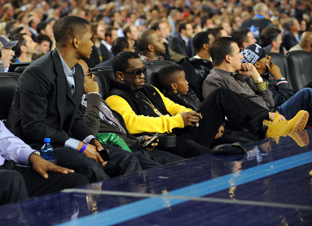 Is Diddy texting during the game?