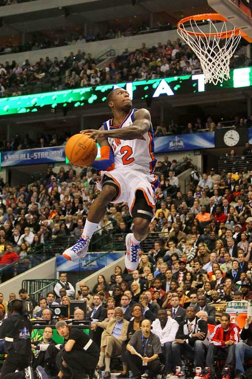 "Nate ""The Great"" Robinson may be a three-time dunk champion, but his last trophy didn't come easy. After his second dunk -- he threw the ball off the backboard, grabbed it and turned in midair for a two-handed backward slam -- the Knicks guard managed to squeak by DeMar DeRozan with 51 percent of fan votes."