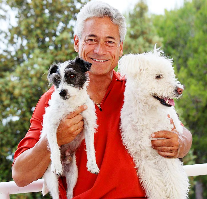 Four-time Olympic gold medalist Greg Louganis with his dogs, Dobby and Hedwig at his home in Los Angeles.
