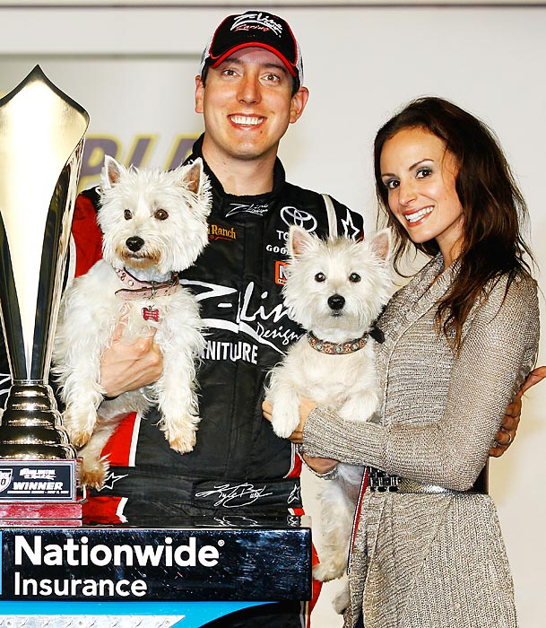 Kyle Busch and his wife, Samantha Sarcinella, celebrate with their dogs in Victory Lane after winning the a Nationwide Series race at Darlington in 2011.