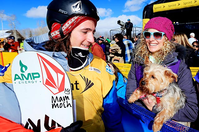 Lindsey Jacobellis, accompanied by her dog Gidget, talks with Luke Mitrani after he finished third in the FIS Snowboard Halfpipe World Cup in Park City, Utah.