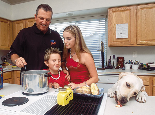 Mark Calcavecchia spends time at home with his children Eric and Britney and the family dog, D.J.
