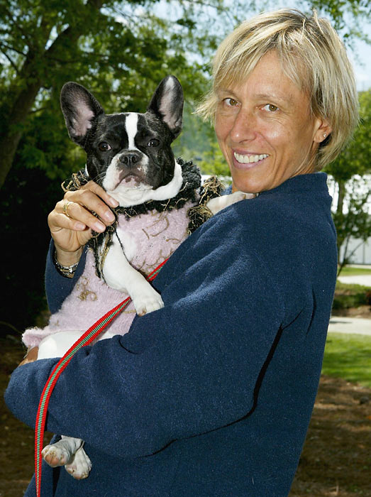 Martina Navratilova poses with one of her many dogs during the Family Circle Cup in Charleston, S.C.
