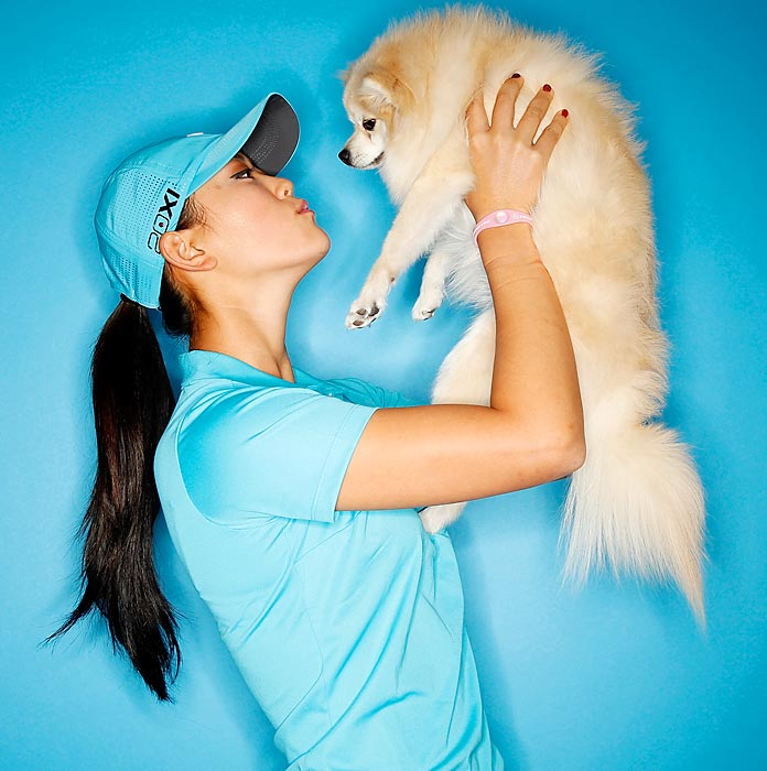Michelle Wie with her Pomeranian, Lola at the Industry Hills Golf Club in California.