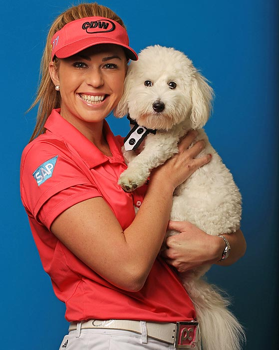 LPGA standout Paula Creamer poses with Studley at her home in Windermere, Fla.