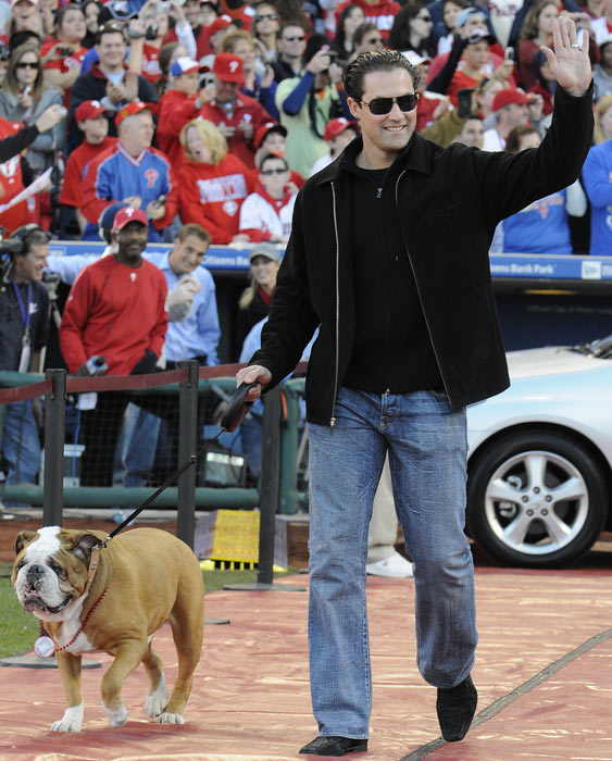 Pat Burrell and his dog Elvis arrive at a victory rally celebrating the Phillies' World Series victory at Citizens Bank Park.