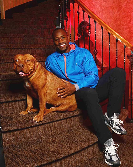 San Francisco 49ers tight end Vernon Davis with his dog during an SI photo shoot in San Francisco.