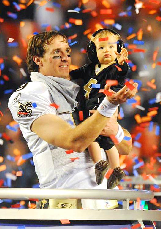 Drew Brees celebrates with his son, Baylen, after defeating the Indianapolis Colts 31-17 in Super Bowl XLIV at Sun Life Stadium in Miami Gardens, Fla.