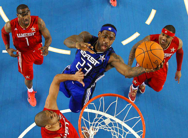 LeBron James of the Eastern Conference goes in for a basket against the Western Conference during the All-Star Game at Cowboys Stadium. The East defeated the West 141-139.