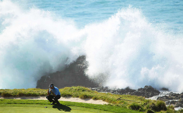 Waves crash on the seventh hole as Paul Goydos lines up a putt at the 2010 ATT Pebble Beach National Pro-Am on Feb. 14. Goydos finished tied for 5th at 12 under.