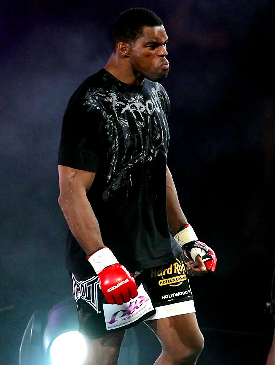 Former NFL star Herschel Walker made his mixed-martial-arts debut Saturday with a third-round TKO of Hungary's Greg Nagy at Strikeforce: Miami at the BankAtlantic Center in Sunrise, Fla. The 47-year-old Walker drove Nagy into the cage early in the third round and subdued him with a barrage of punches, prompting referee Troy Waugh to stop the fight.<br>The 1982 Heisman Trophy winner, a fifth-degree black belt in tae kwan do, donated his entire winnings to charity.