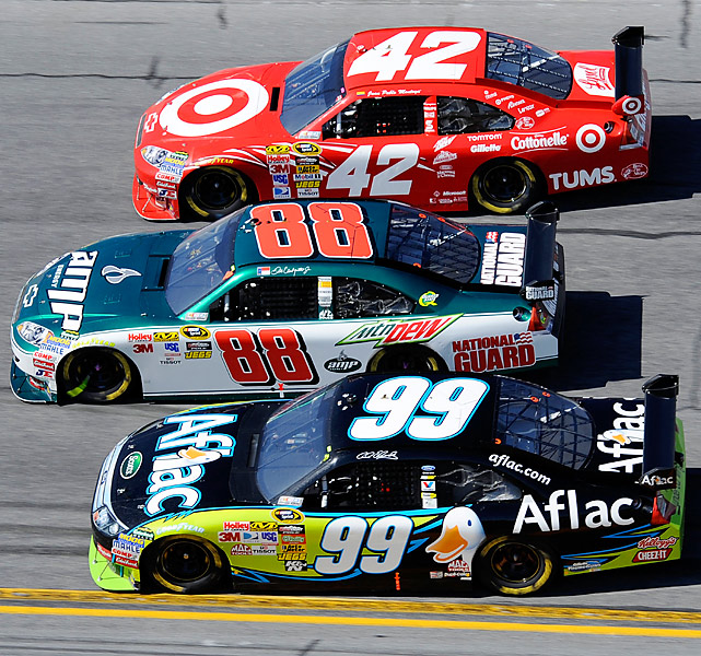 Dale Earnhardt Jr. (88), who eventually finished second, splits Carl Edwards (99) and Juan Pablo Montoya (42) early in the race.