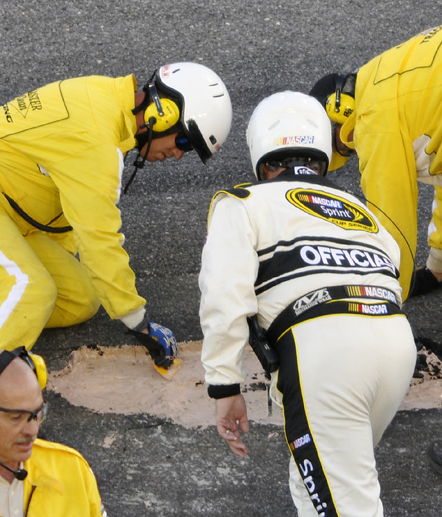 NASCAR officials work to fix a pothole on the Daytona track that caused two significant delays.