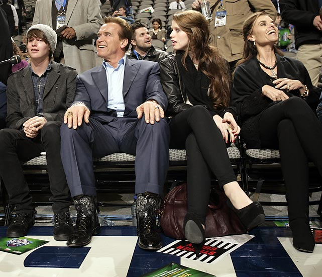 California governor Ahhh-nahld Schwarzenegger, wife Maria Shriver and their kids watched from courtside.