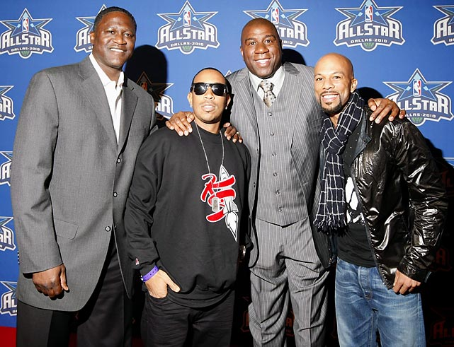 Dominique Wilkins, rapper Ludacris, Magic Johnson and rapper Common all posed for the media before the game.
