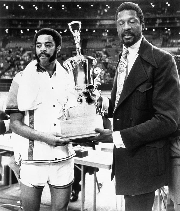 Frazier, here with Bill Russell, had 30 points and 11 rebounds to win MVP honors in the East's 108-102 victory.