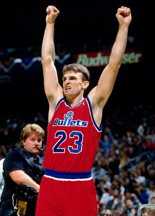 Legler celebrates after winning the 1996 three-point contest.