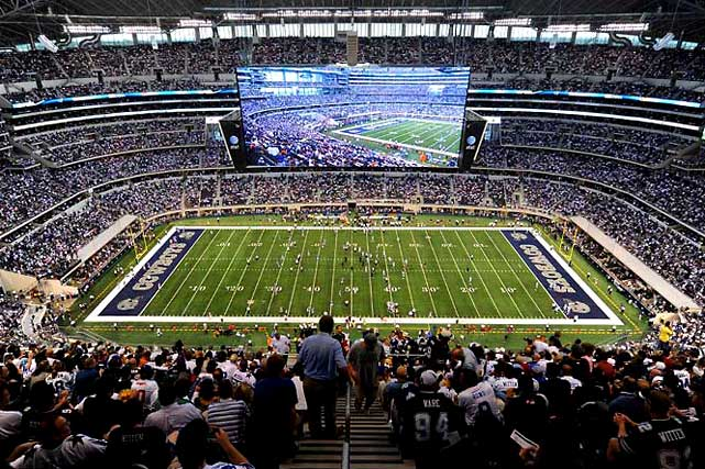 It cost $1.2 billion to build, it costs $75 to park your car there, and 90 feet above its field hangs the world's largest high-definition television -- 11,520 square feet of brightly glowing pixels. Fears that the new Cowboys Stadium's display would be struck with a punt -- as Tennessee's A.J. Trapasso managed to do during the preseason -- proved unfounded in the regular season. And much to the delight of Cowboys fans, Jerry Jones' NFL-style Taj Mahal played host to an altogether more welcome moment: the franchise's first playoff win since 1996, a 34-14 demolition of the Eagles on Jan. 9.
