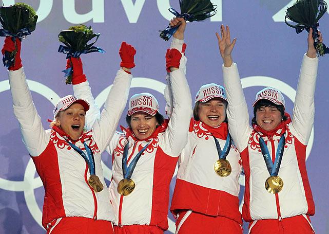 Gold medalists Svetlana Sleptsova, Anna Bogaliy-Titovets, Olga Medvedtseva and Olga Zaitseva of Russia.