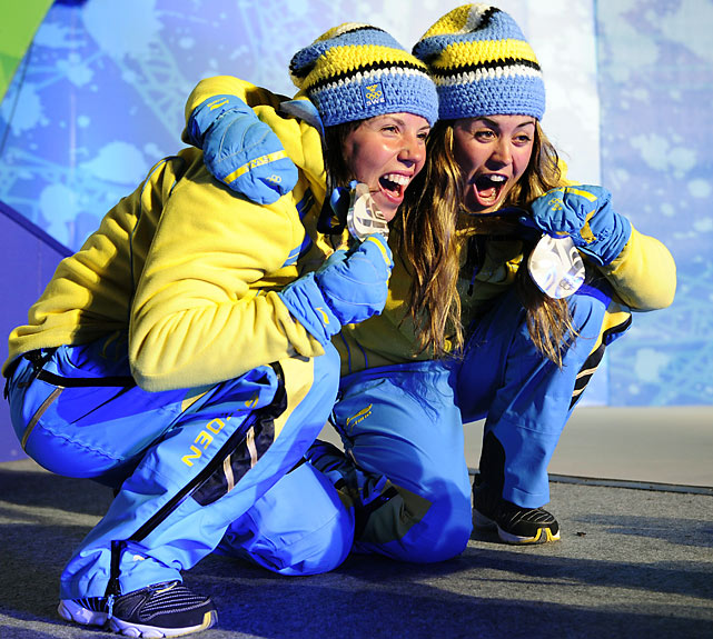 Sweden's silver medallists Charlotte Kalla (left) and Anna Haag.