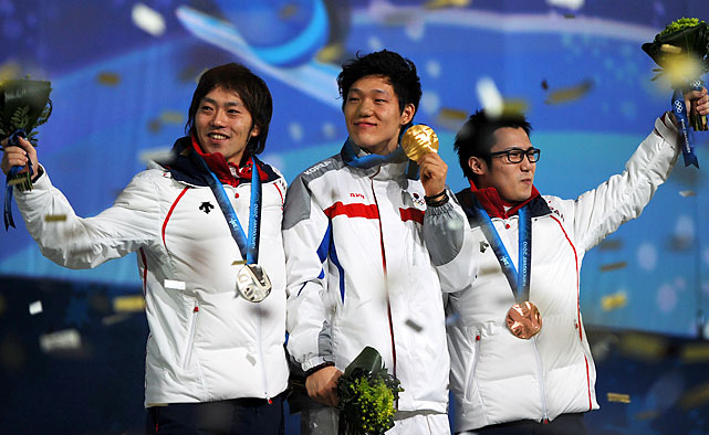South Korea's gold medalist Mo Tae-Bum (center), Japan's silver medalist Keiichiro Nagashima (left) and Japan's bronze medalist Joji Kato.