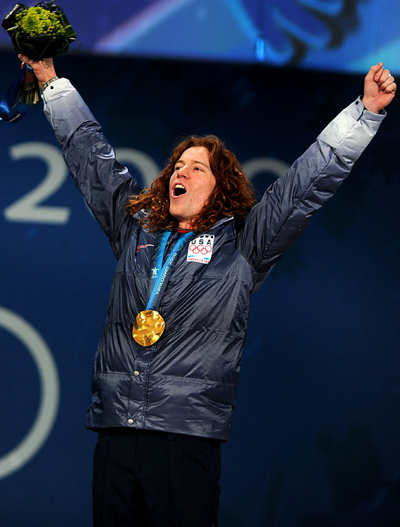Shaun White of the U.S. celebrates with the gold medal around his neck.