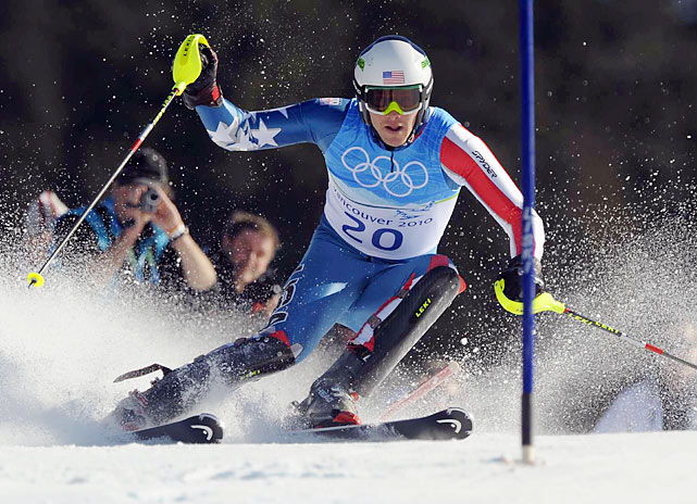 Bode Miller won the first gold medal of his Olympics career, taking the super-combined with plenty of flair -- roaring back from seventh after the downhill with a blazing slalom run.