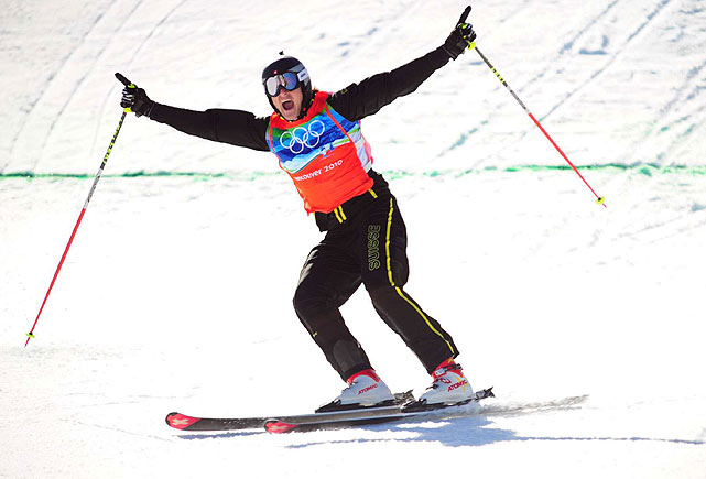 Switzerland's Michael Schmid won the Olympics debut of men's skicross, a cousin to the NASCAR-on-ice snowboarding race featuring four racers charging through a winding course filled with jumps.