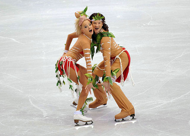 Reigning world champions Oksana Domnina and Maxim Shabalin, leaders after the compulsory dance, dropped to third following the original dance competition. <br>Domnina and Shabalin did tone down their costumes. The color of their bodysuits is now more beigey than brown. Some of the white markings they had on their legs and arms were removed or toned down. But he was still dressed in a loin cloth, and both were covered with leaves.