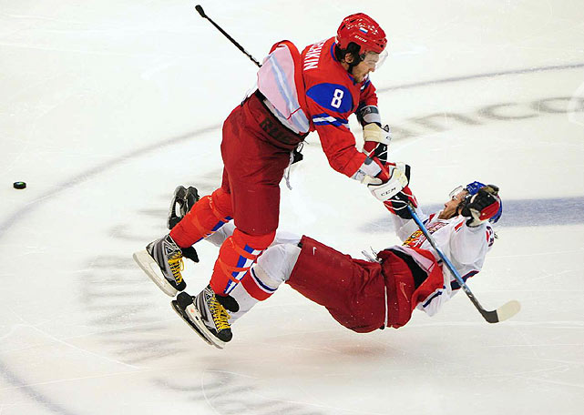 In a game in which Russia's Alex Ovechkin flattened Jaromir Jagr with a hit at center ice that also broke his visor, the Russians won 4-2 to claim first place in their group.