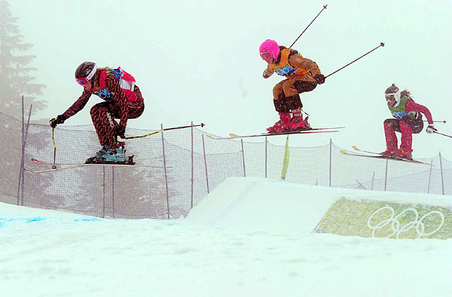 Canada's Ashleigh McIvor (left) defeated Norwegian Hedda Berntsen in the final of the Olympic debut of women's skicross, held in heavy snow.