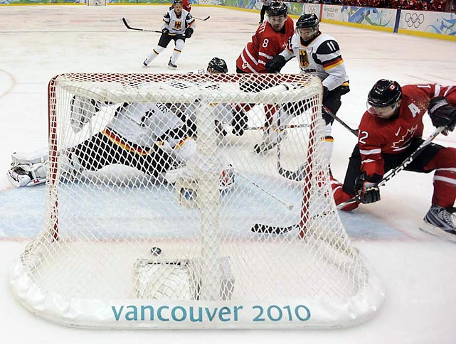 Canada rebounded from its men's hockey loss to the United States to beat Germany 8-2 and set up a quarterfinal against Russia.