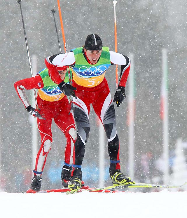 Austria successfully defended its title in the Nordic combined team relay, overtaking the United States in the last straight of the cross-country section after placing third in the ski-jumping portion of the event.
