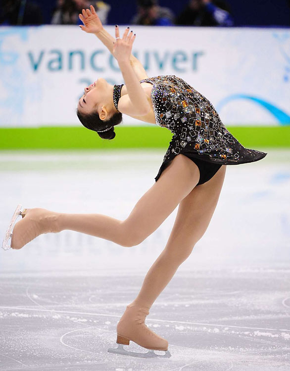 South Korea's Kim Yu-na had fans and judges swooning in the short program, scoring 78.5 points to shatter her own record and put her almost five points ahead of longtime rival Mao Asada of Japan.