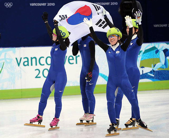 The South Korean relay team's celebration didn't last long as they were disqualified for clicking skates with China just after an exchange with five laps to go in the 3,000-meter event..