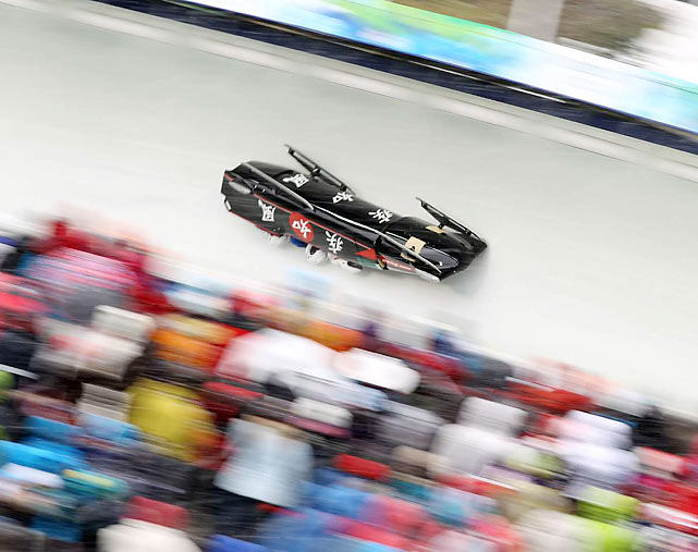 Six bobsleds, including one from the United States and Japan (pictured), crashed during the first two heats of Olympic four-man bobsled - all in turn No. 13. There were no serious injuries.