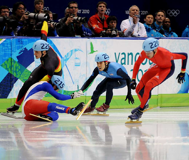 Apolo Ohno had to avoid a pair of tumbling Olympians to reach the semifinals of the 500.