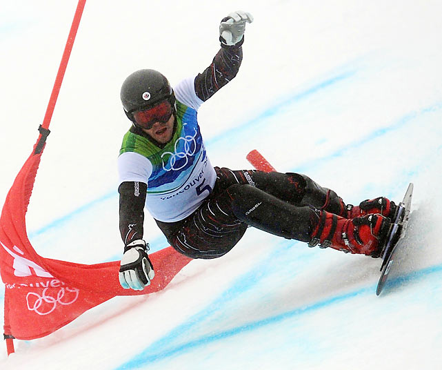 Canada's Jasey-Jay Anderson, a seven-time World Cup champion, carved through the rain-sluiced, fogged-in parallel giant slalom course to take down Austria's Benjamin Karl, the top-ranked rider in the world, for the gold.