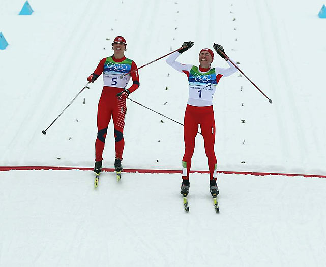 In the women's 30k classical race, Poland's Justyna Kowalczyk beat Norway's Marit Bjoergen in a photo finish. Kowalczyk, the World Cup leader, now has a medal of each color.