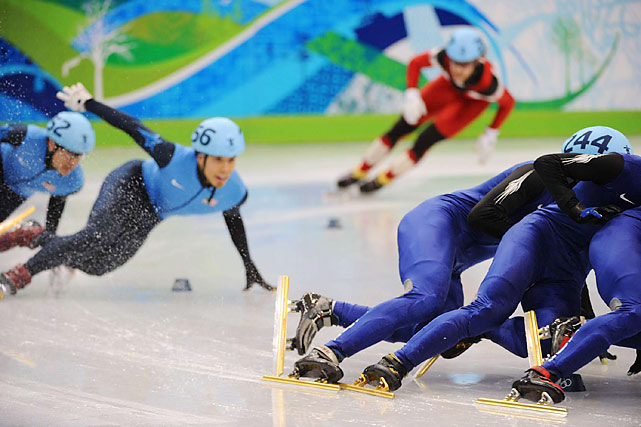 Apolo Anton Ohno (second from left) and teammate J.R. Celski were in fourth and fifth, respectively, and trailing three South Koreans heading to the finish line in the 1,500-meter short track final. That is until ...
