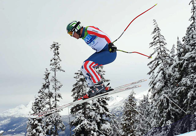 America's most decorated Alpine skier, Bode Miller earned a bronze medal in the downhill on Monday. He finished nine-hundredths of a second behind winner Didier Defago of Switzerland, the smallest margin between gold and bronze in the history of the event, which began in 1948.